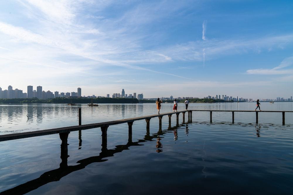 people standing on dock