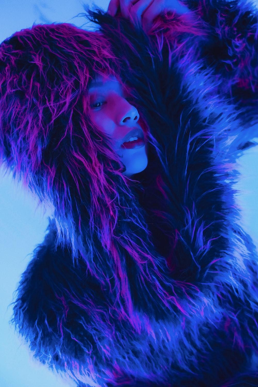 portrait of woman wearing fur jacket