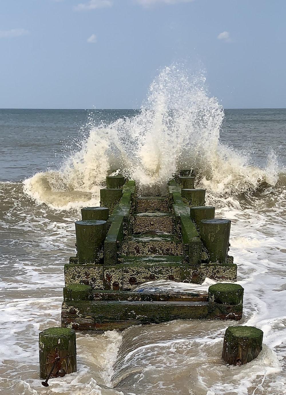 water wave beside sea dock