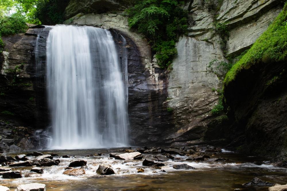 waterfalls beside rock formation