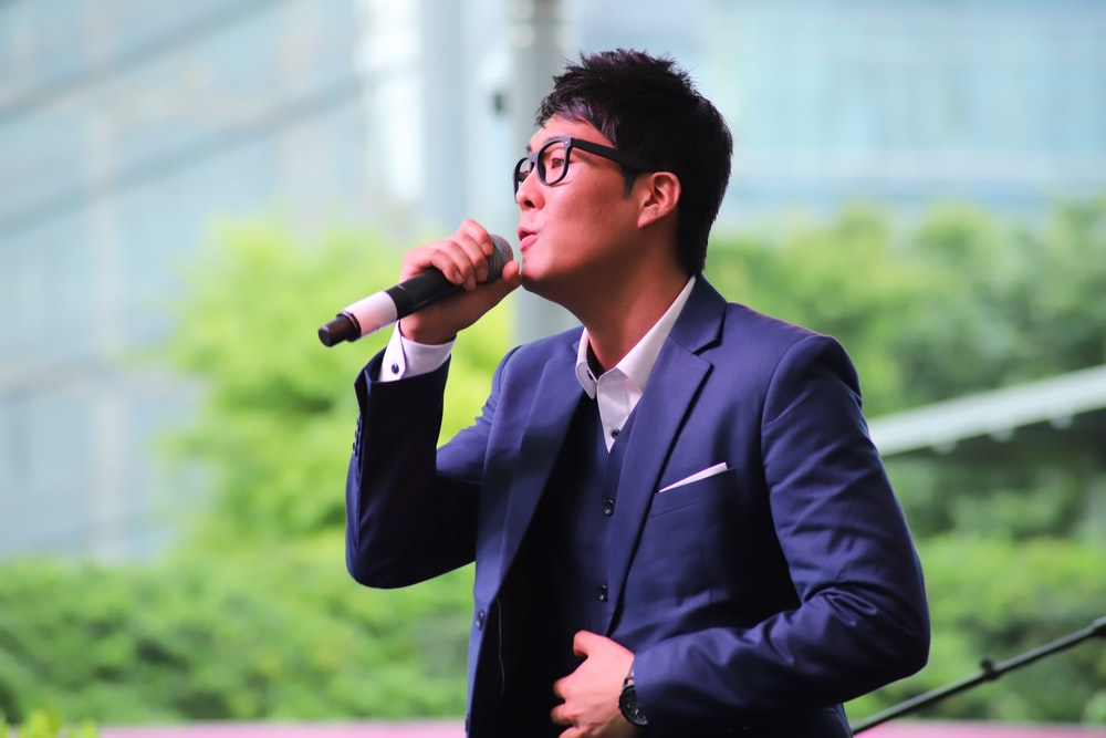 man holding dynamic microphone