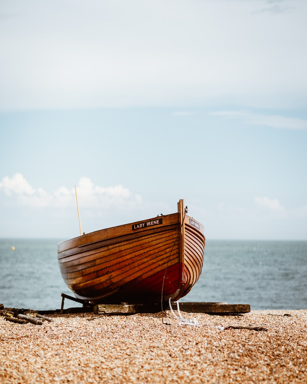 brown boat near body of water