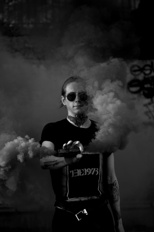 man holding smoke