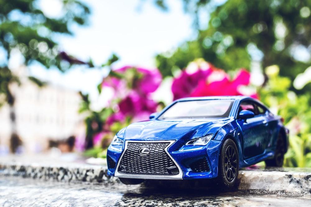 blue Lexus coupe on road