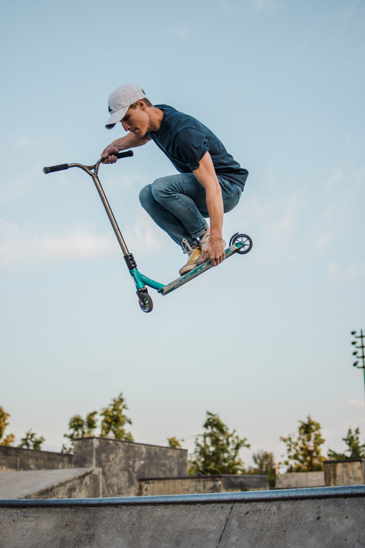 man flipping kick scooter