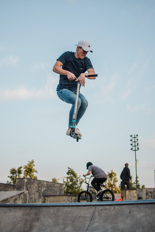 man playing kick scooter