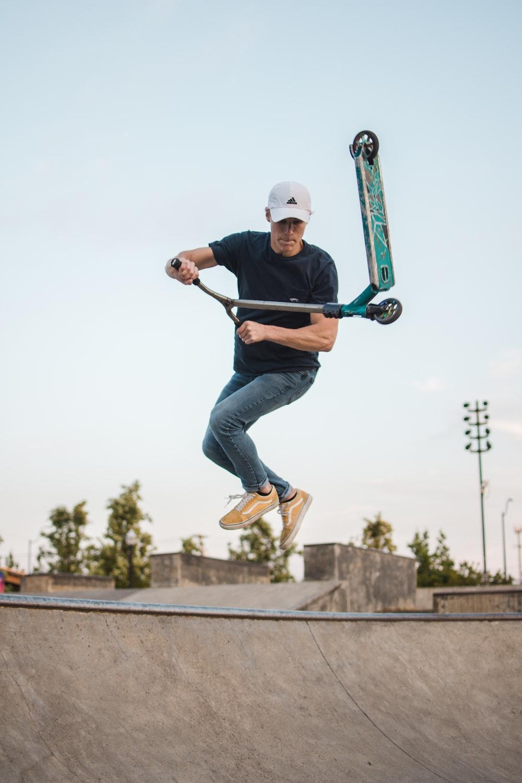 man doing tricks on a kick scooter