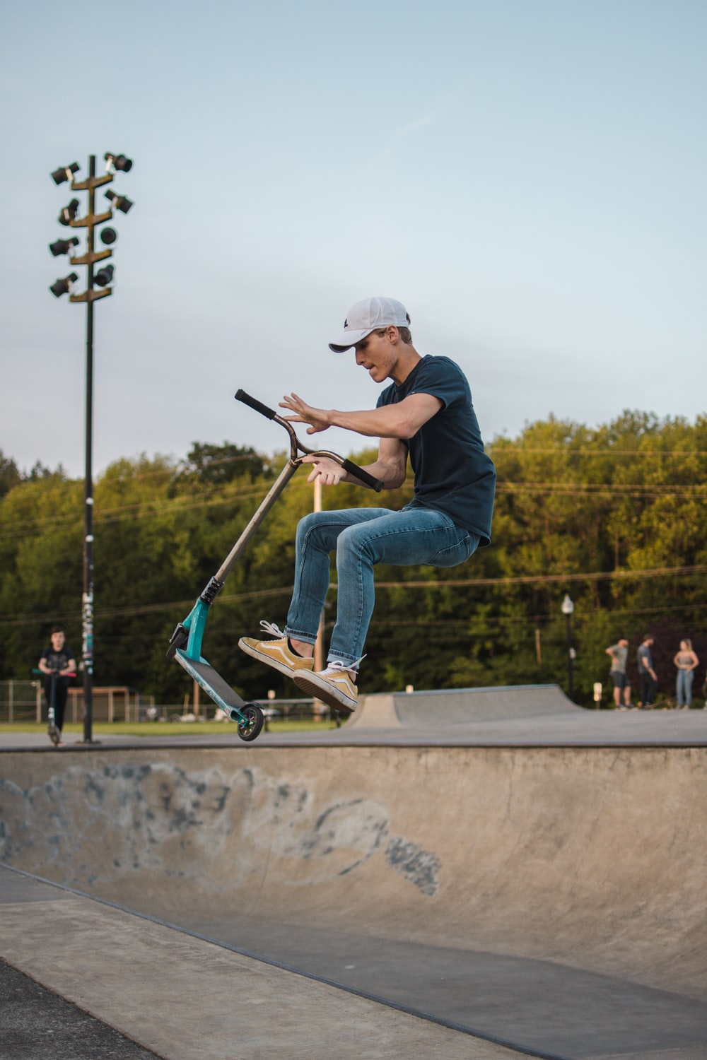 man jumping with kick scooter