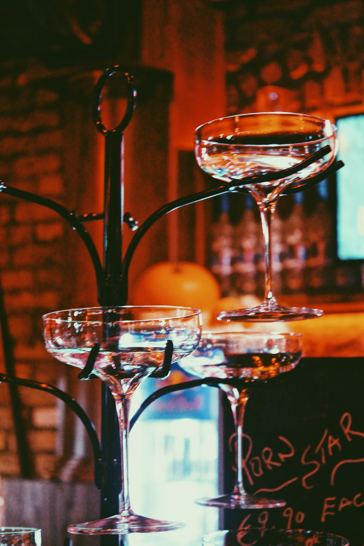 clear cocktail glasses on black rack