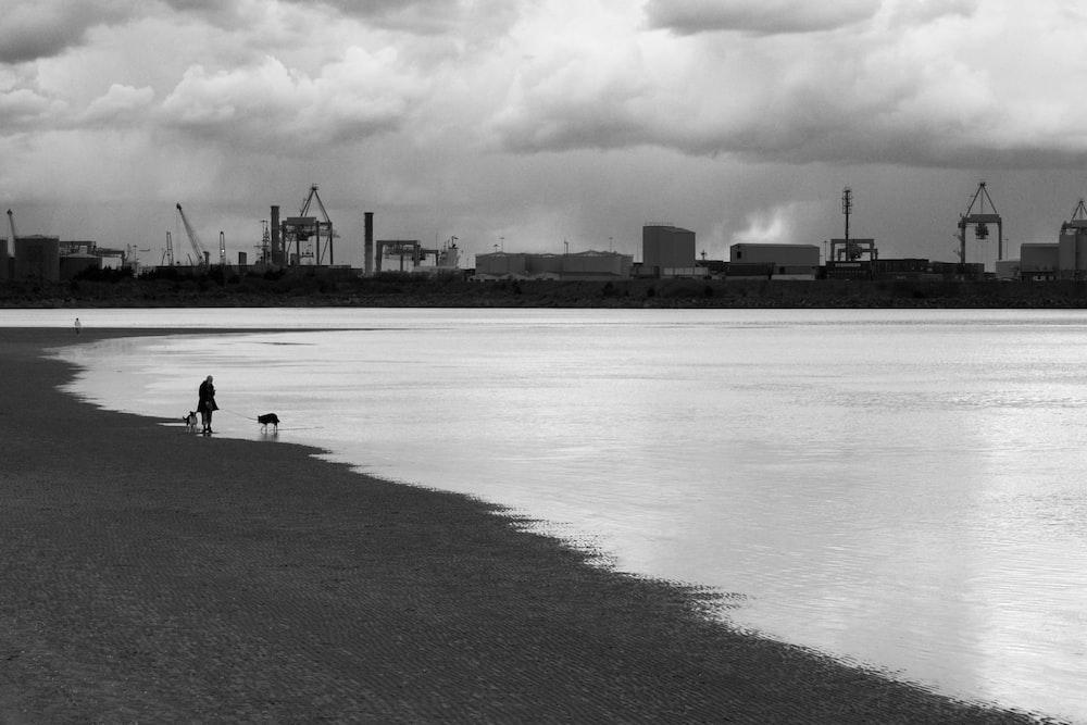 man walking at the beach
