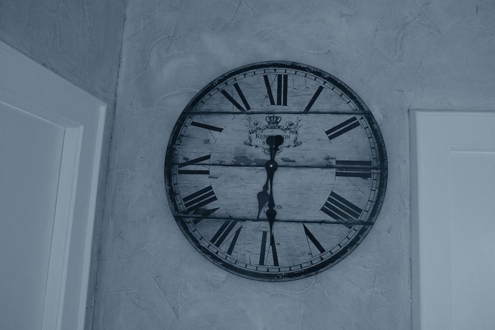 round gray and white analog wall clock