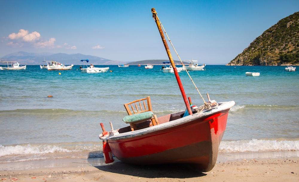 red boat in seashore
