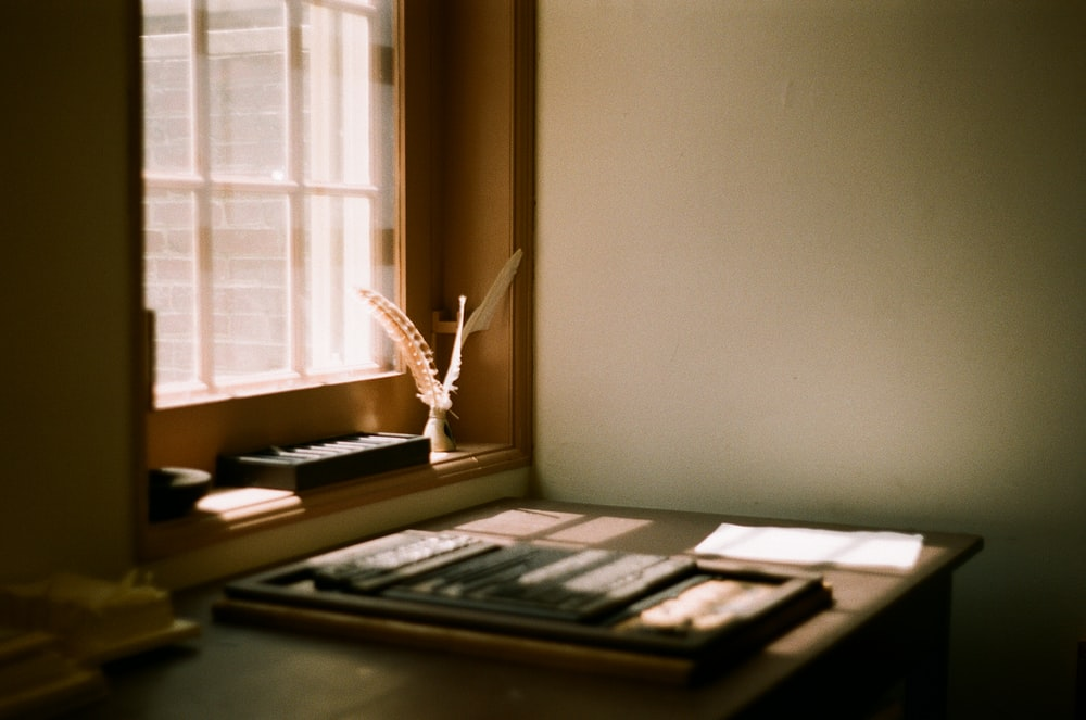 brown wooden desk with writing tools