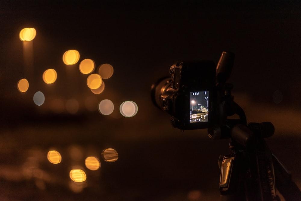 black DSLR camera with bokeh lights