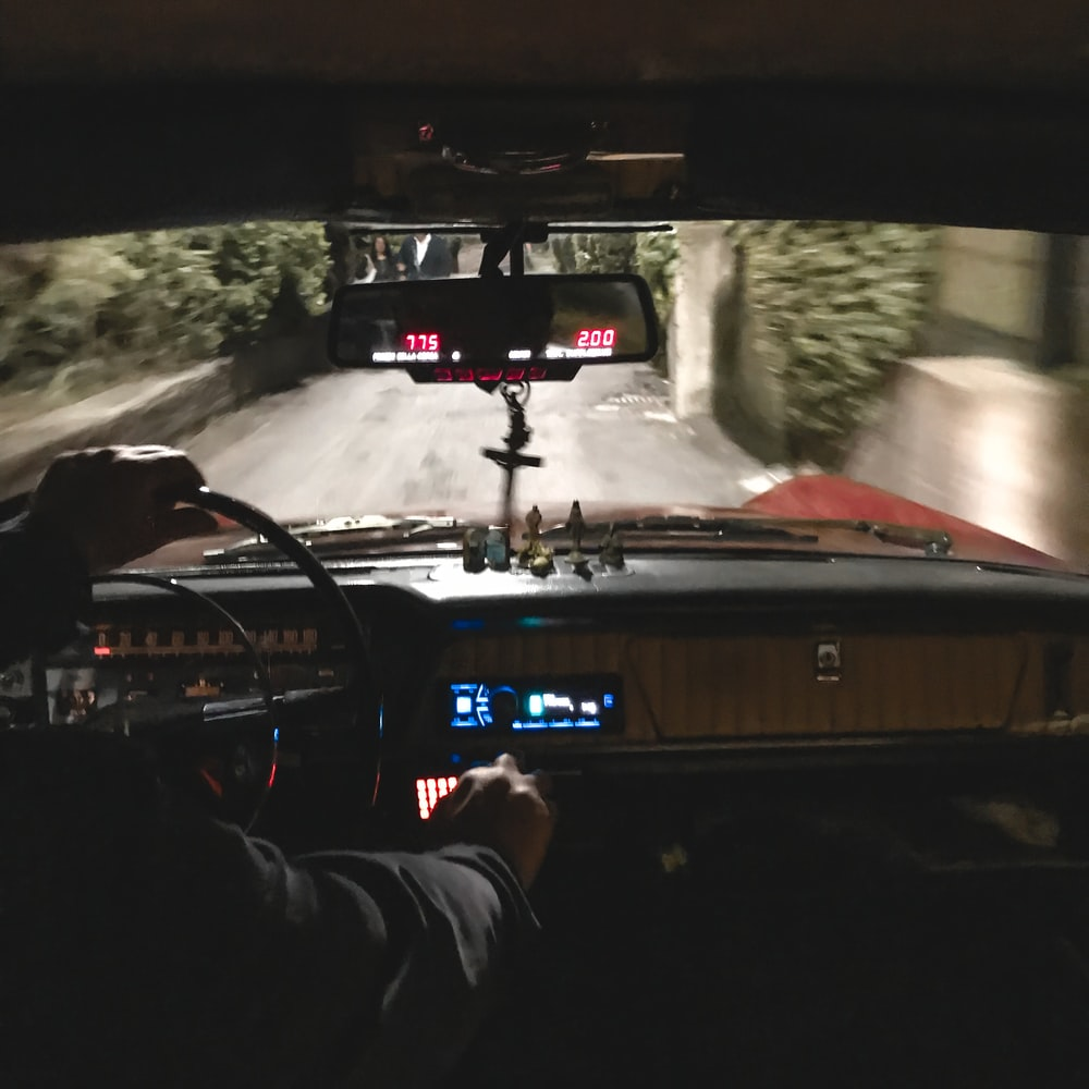 man driving classic car