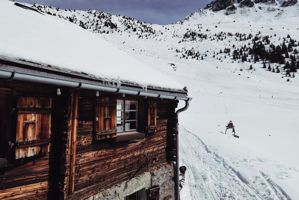 brown house on snowfield