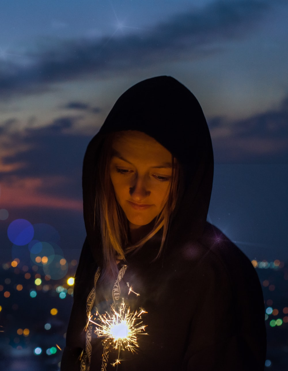 portrait of woman holding fireworks