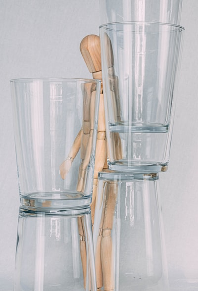 five clear drinking glasses