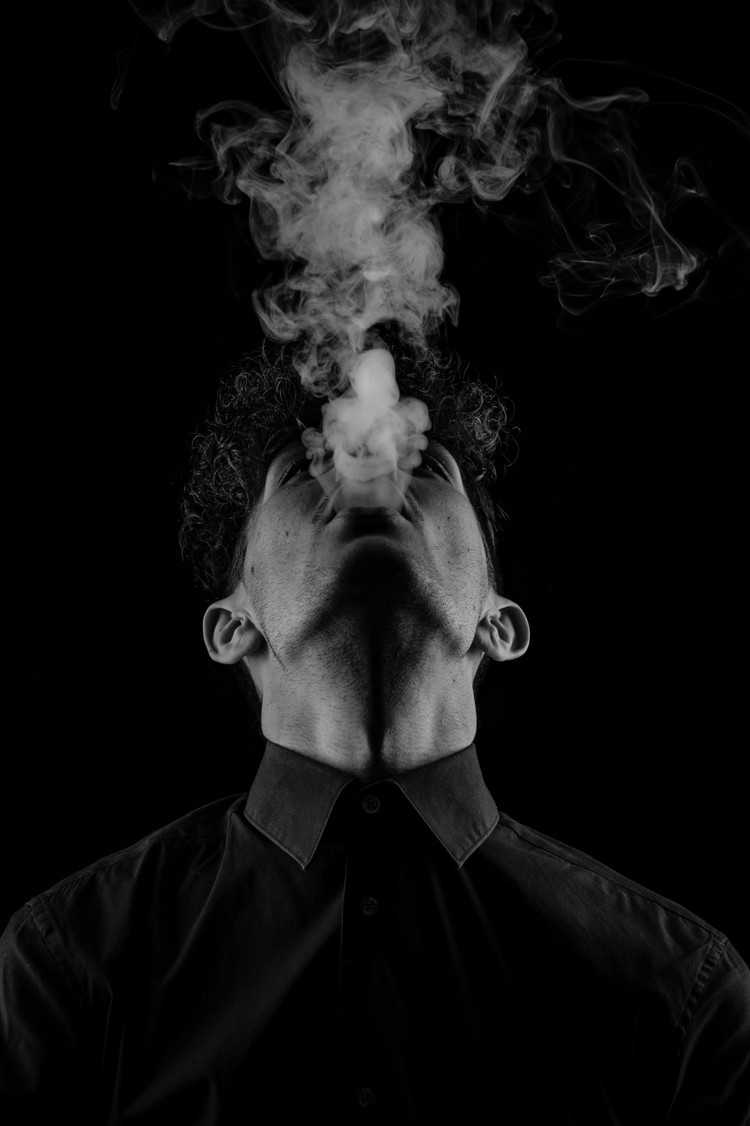 Black and white photo of a men smoking