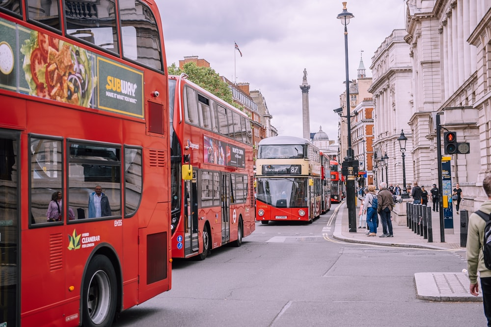 several double-decker buses on road