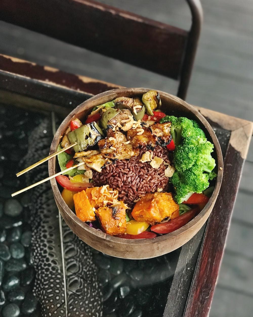 a wooden bowl full of vegan dish