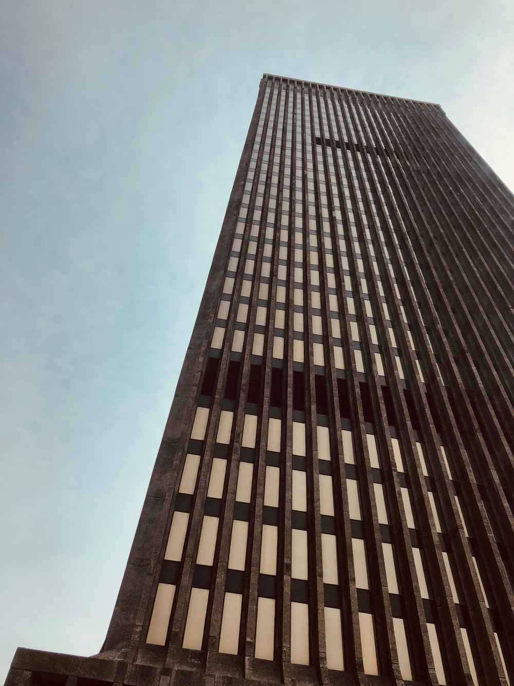 brown concrete high-rose building during daytime