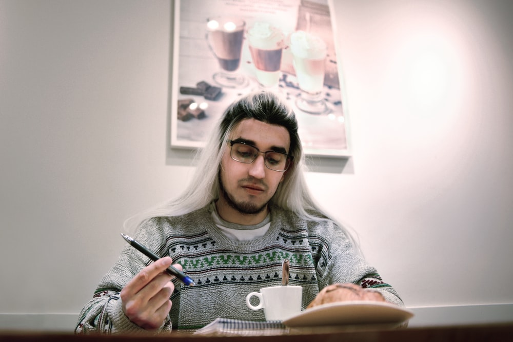 man holding pen