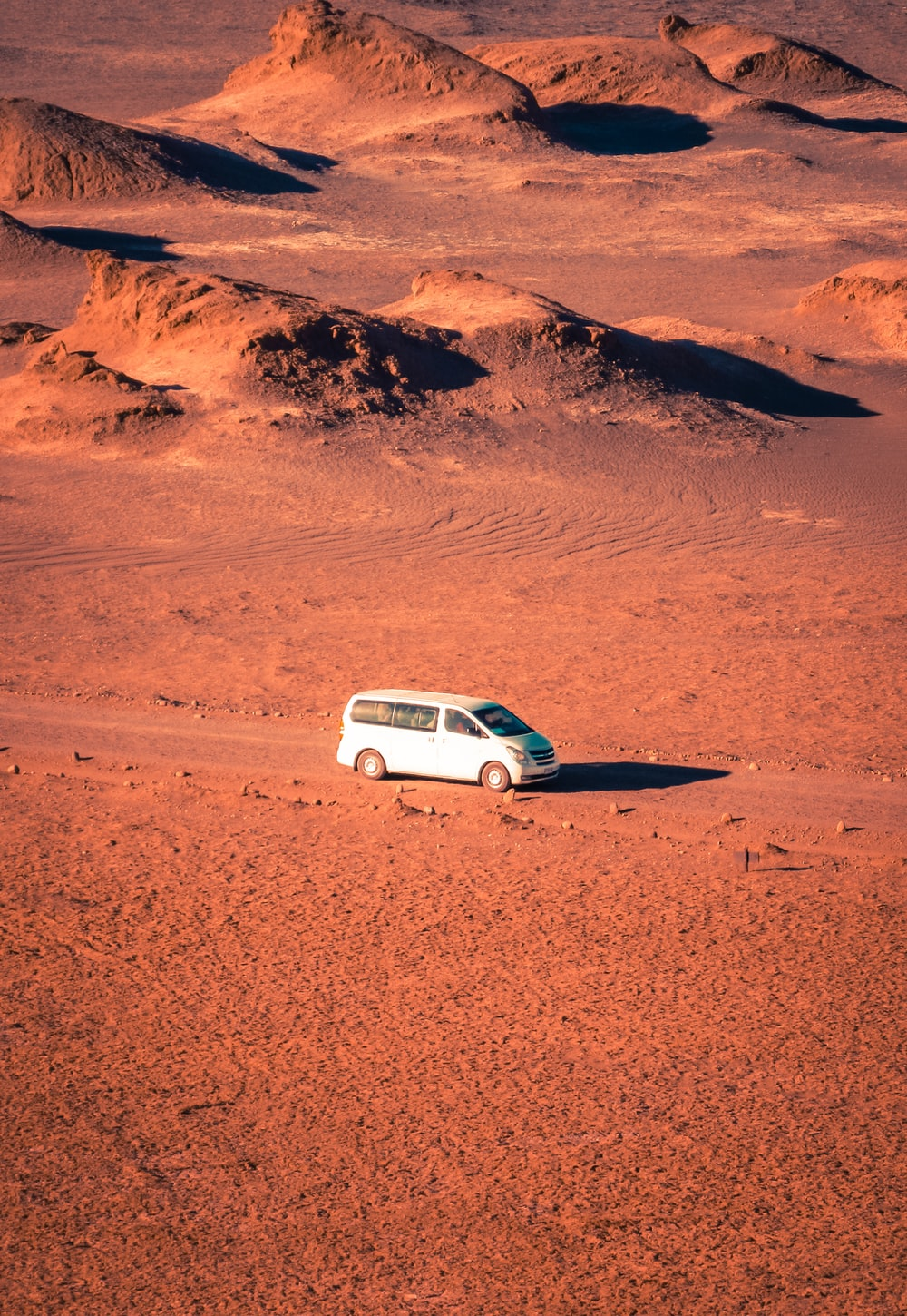 white van on desert photo