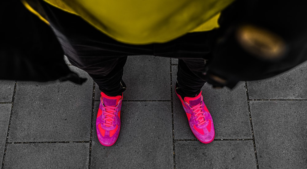 person wearing pink shoes