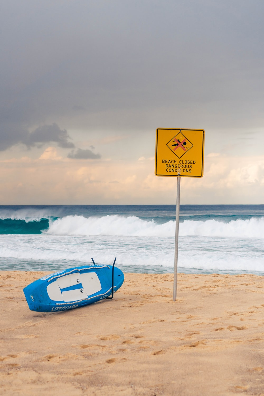 white and black wake board near yellow signage