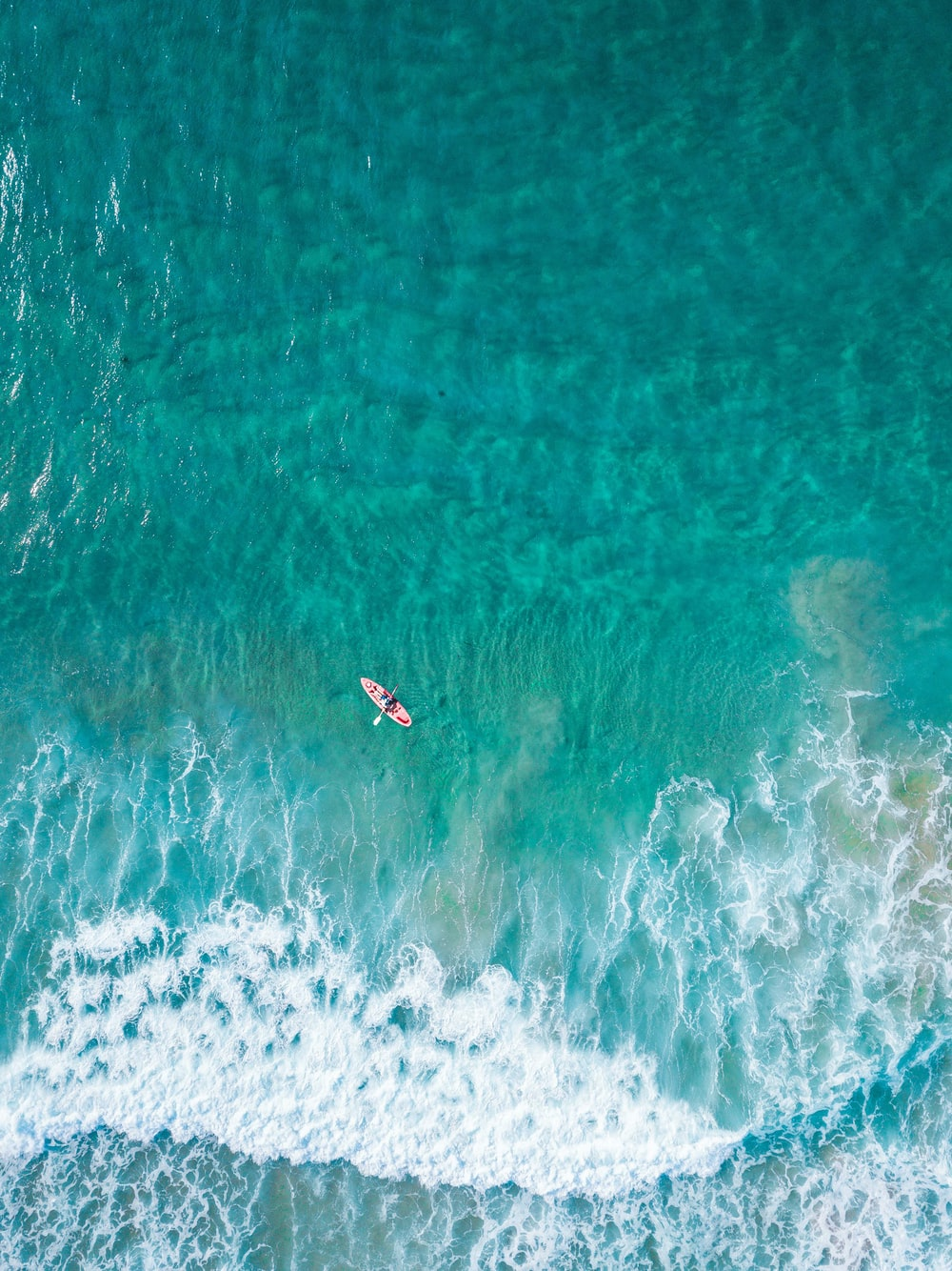 aerial view of person at the boat on the ocean
