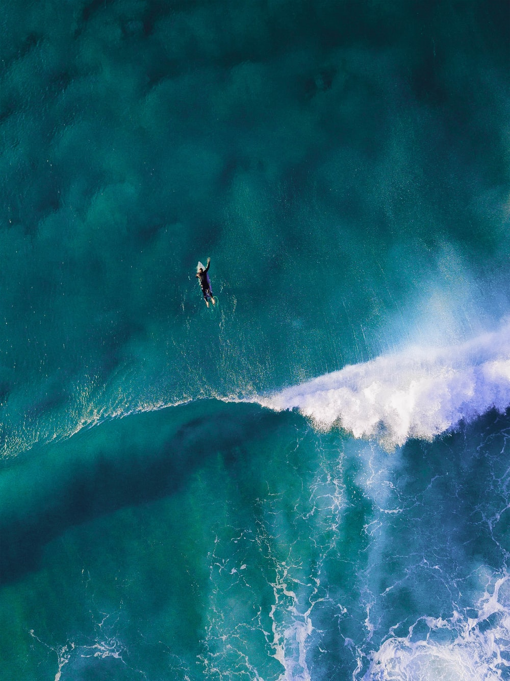 high-angle photography of man surfing giant wave