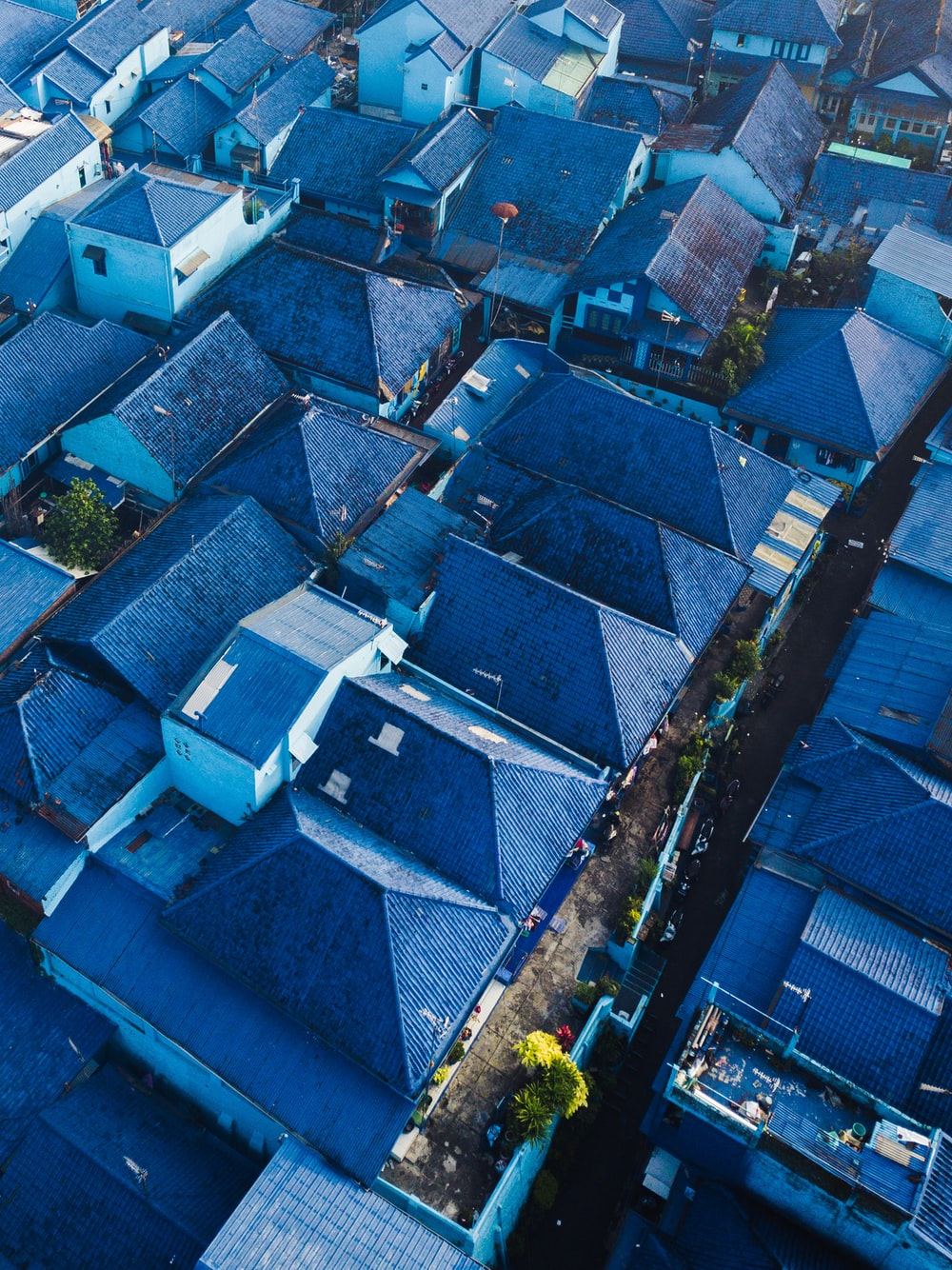 aerial photography of blue-roofed houses during daytime