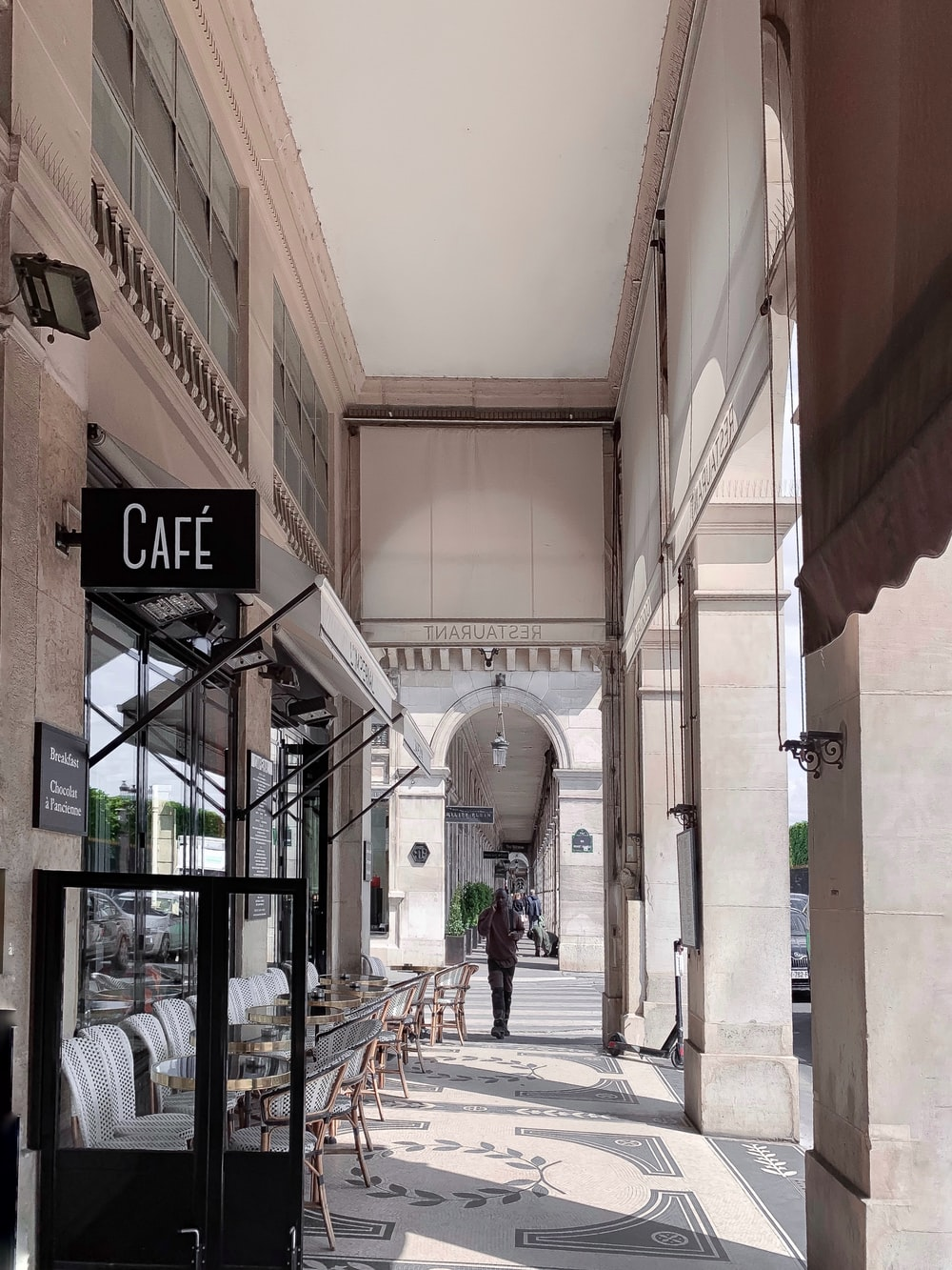 man walking beside cafe