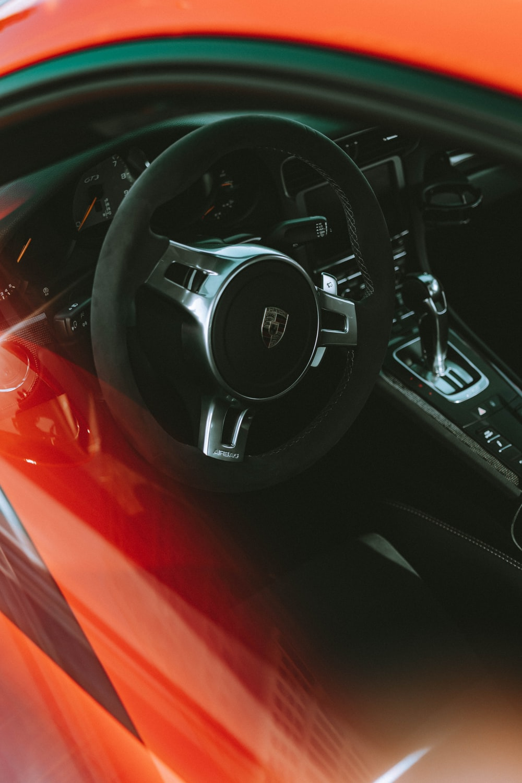 black and gray Porsche vehicle steering wheel