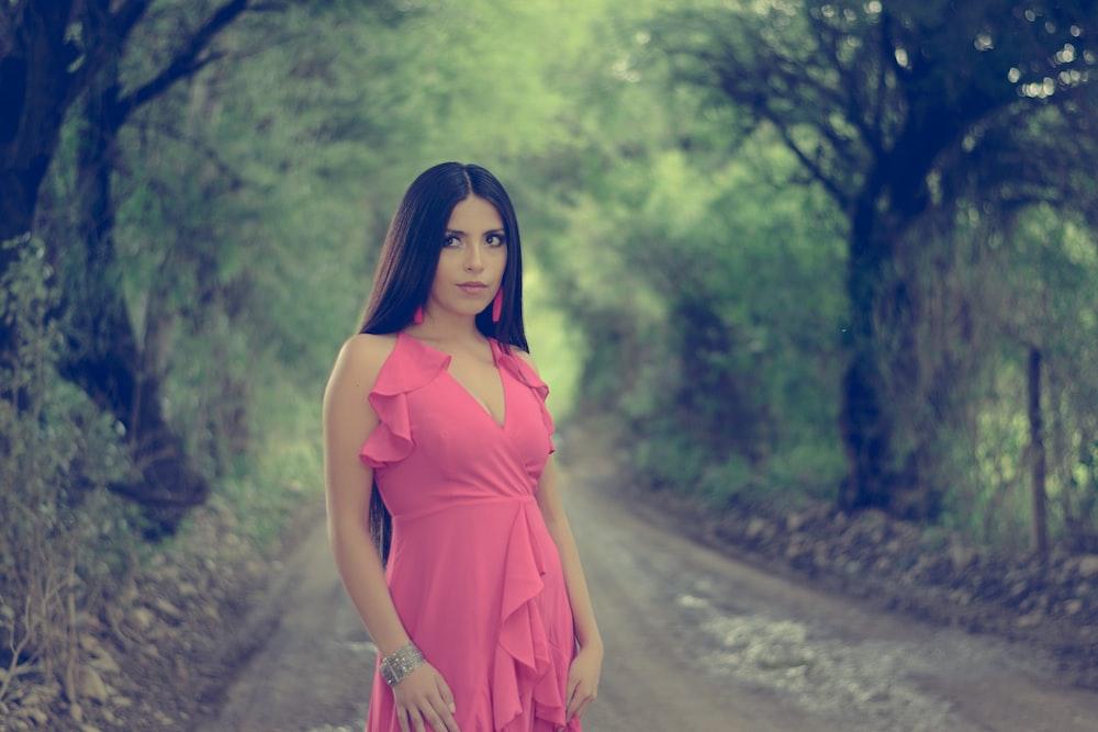 woman in pink deep V-neck sleevlessleeveless dress