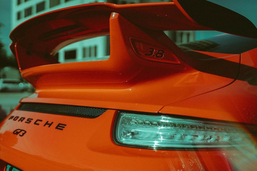 orange Porsche Q3 vehicle