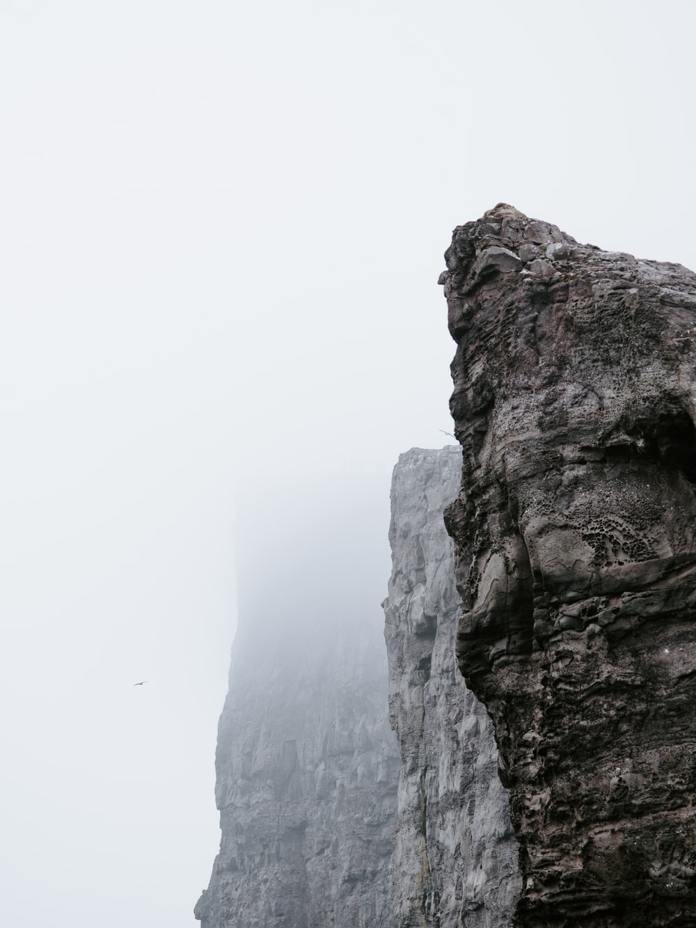 gray rock formations with fog