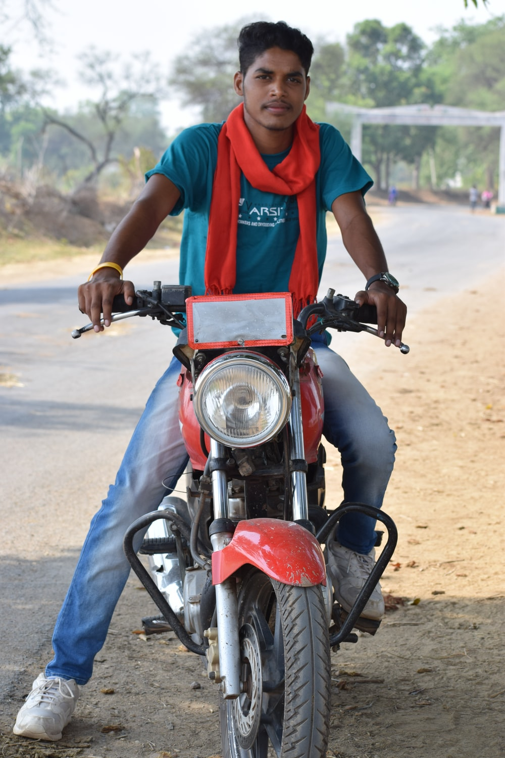 man on red motorcycle