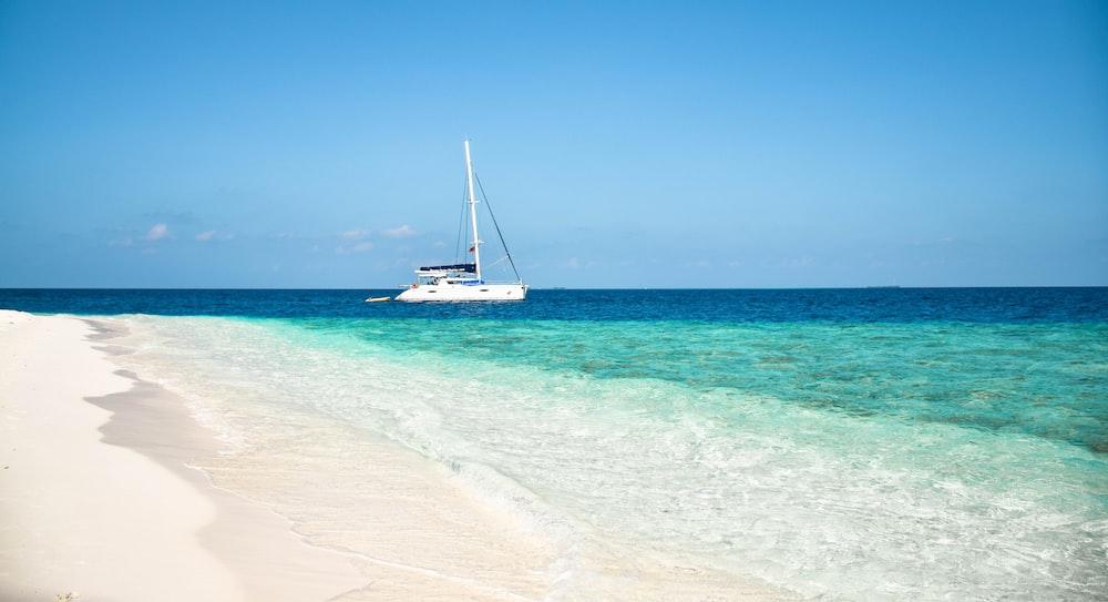 white sailship near shore