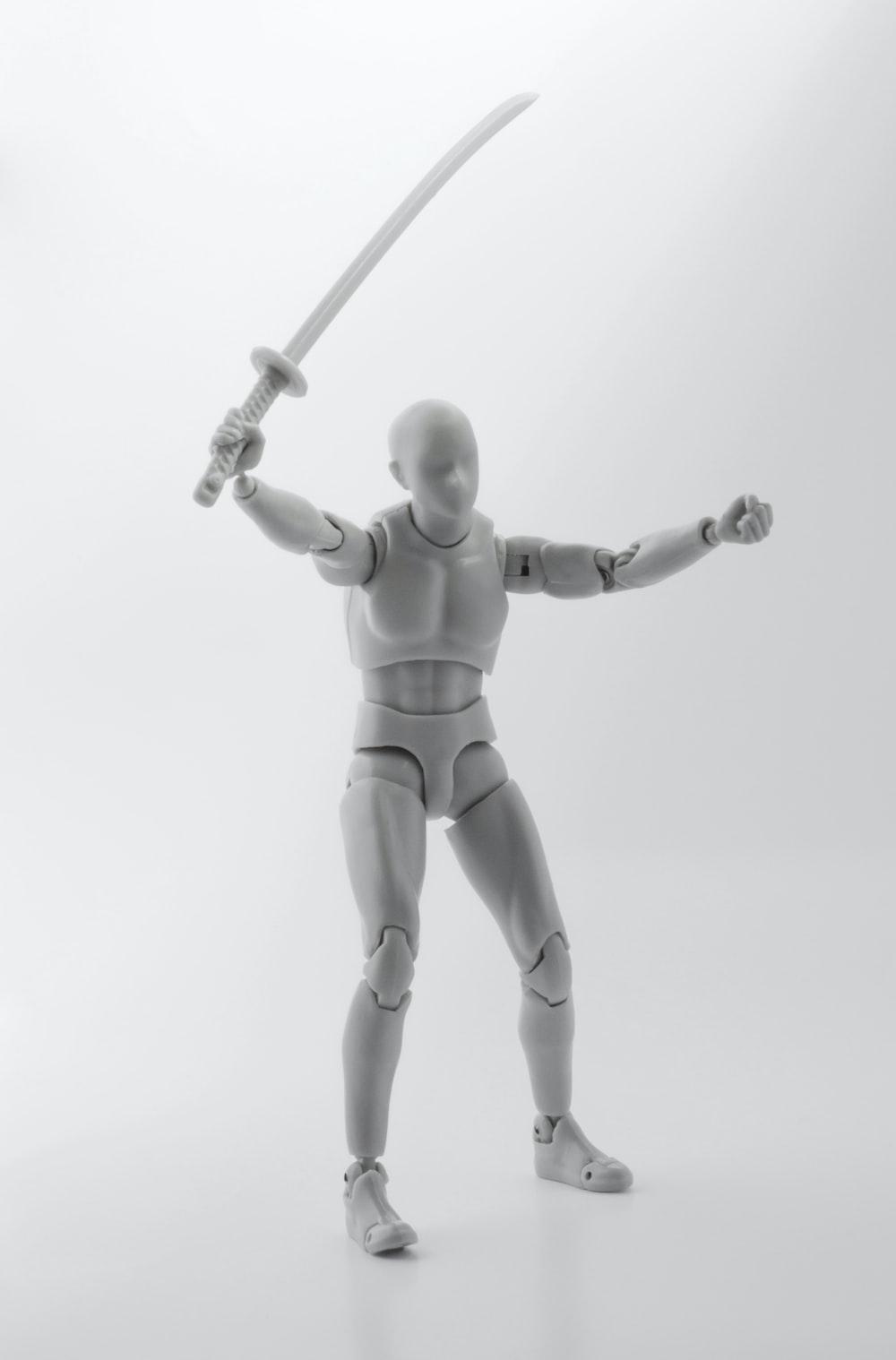 man holding sword action figure