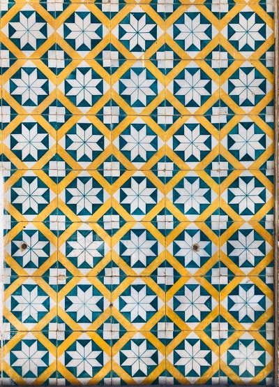 yellow and white floral textile