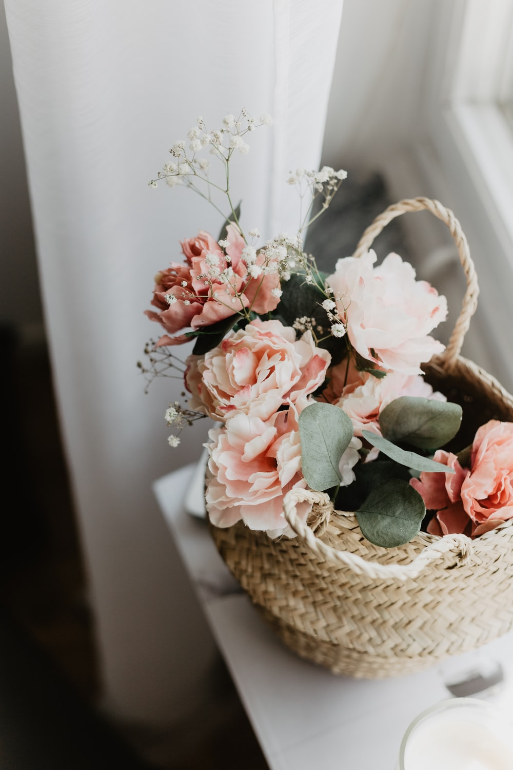 flowers centerpiece in brown wicker basket