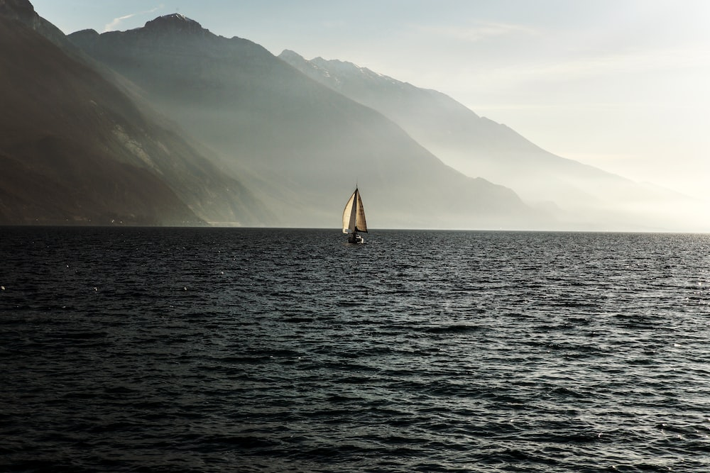 sailboat at the ocean surrounded with fog