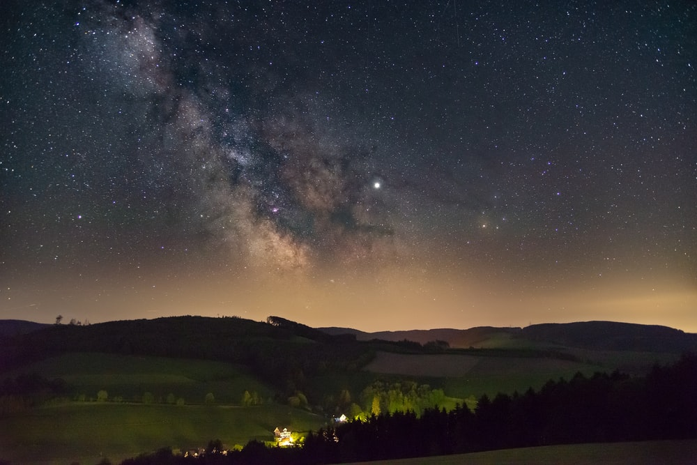 starry night sky over the valley