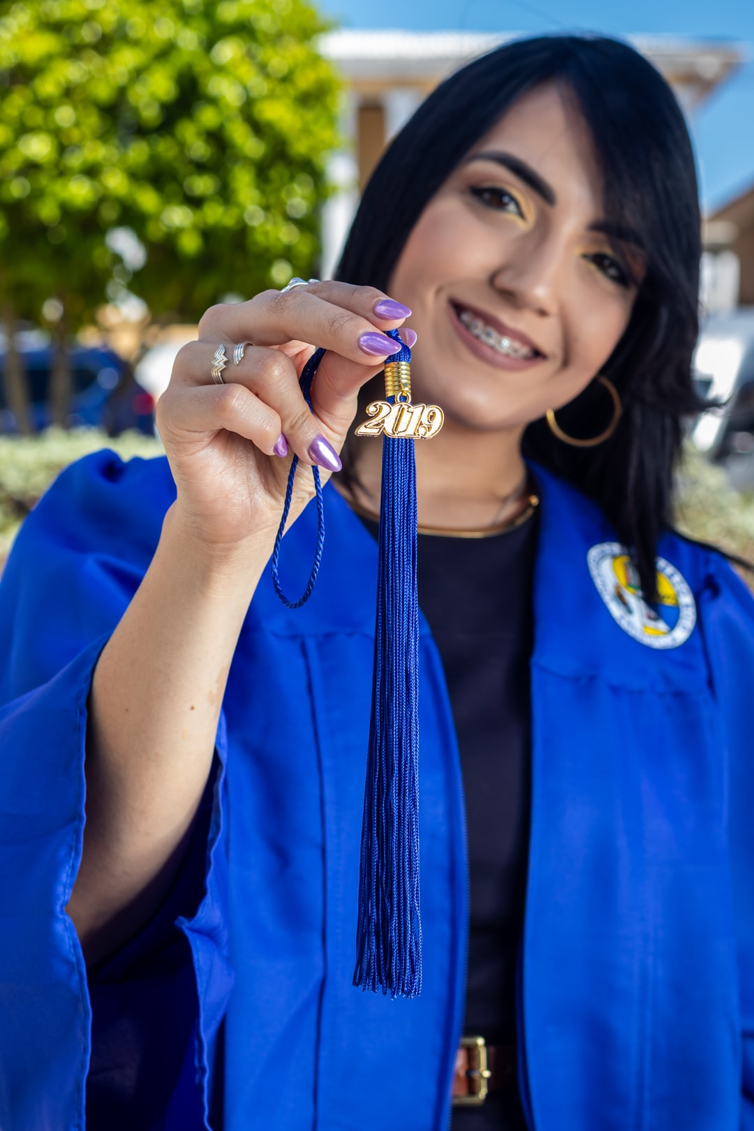 My best friend finished her college bachelor degree in human resources. When she told me she was graduated I insisted in taking her graduation pictures. As I was taking these, i really wanted to capture every detail that i thought would be memorable for her in the long run. I really wanted to capture the 2019 and her Wonder Woman ring because she identifies as a young, strong, independent, entrepreneur.
