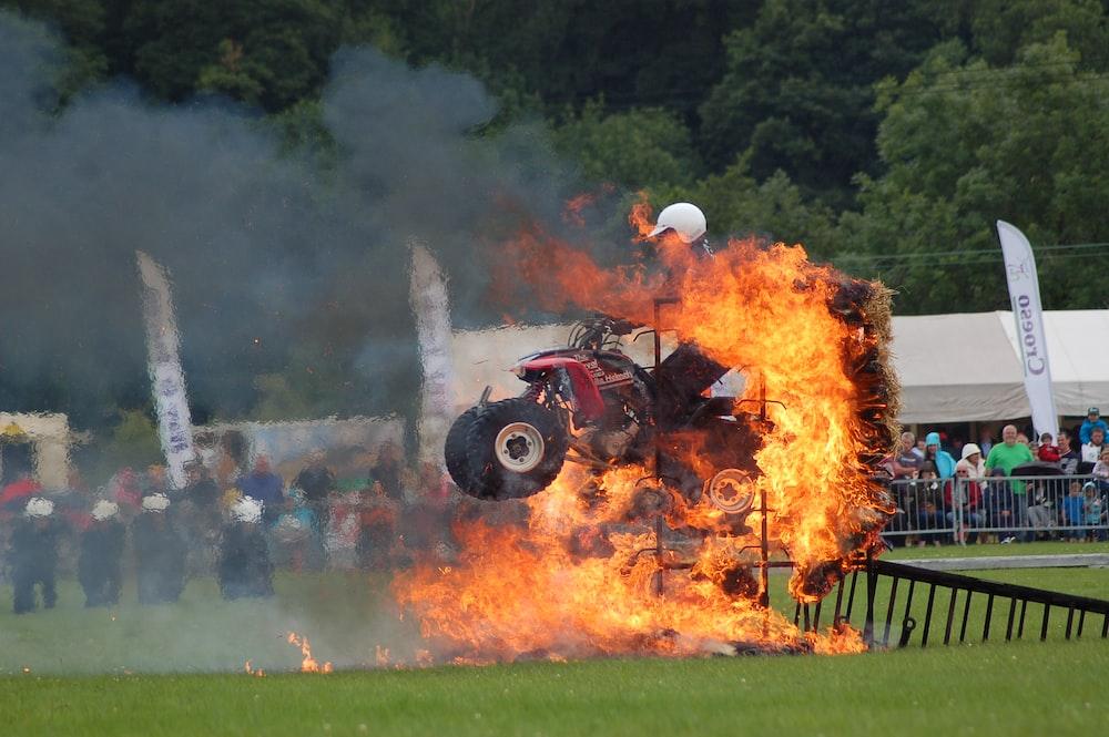 red ATV jumping on fiery ramp