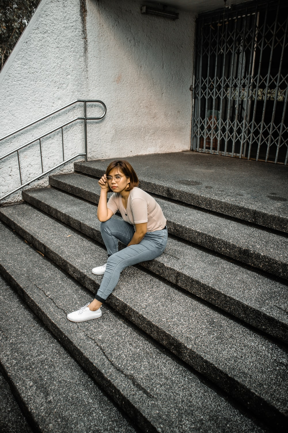woman sitting on concrete stair