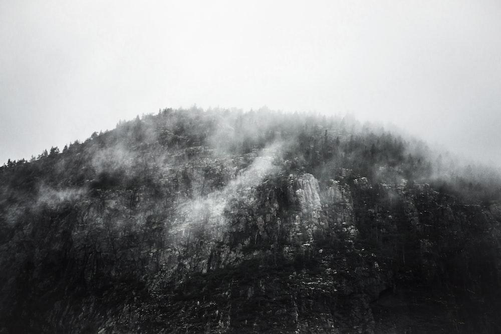 greyscale photography of mountain