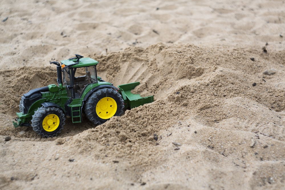green and black tractor toy